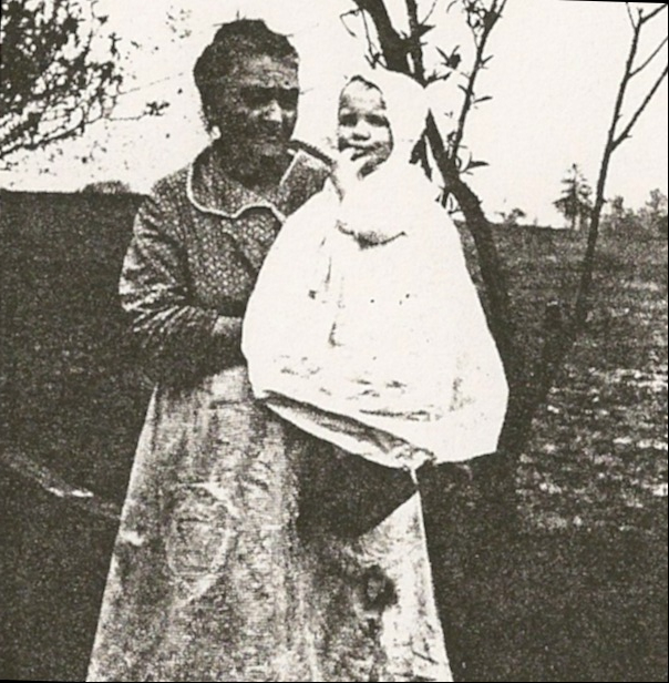 "Mary Elizabeth (Gilliland) Rakestraw with her great grandson, Sanford ""Bud"" Wiseheart, circa 1924."